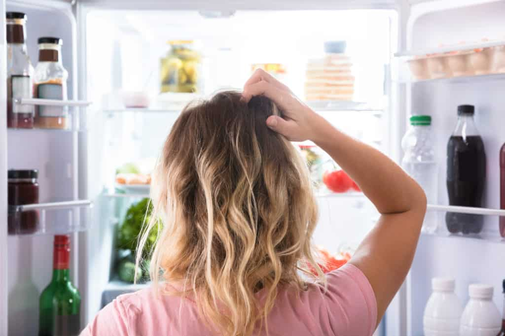 woman scratching her head wondering what's for dinner