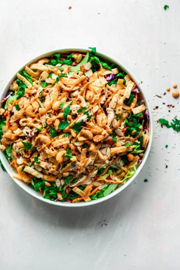 Asian chopped salad with rotisserie chicken and peanuts.