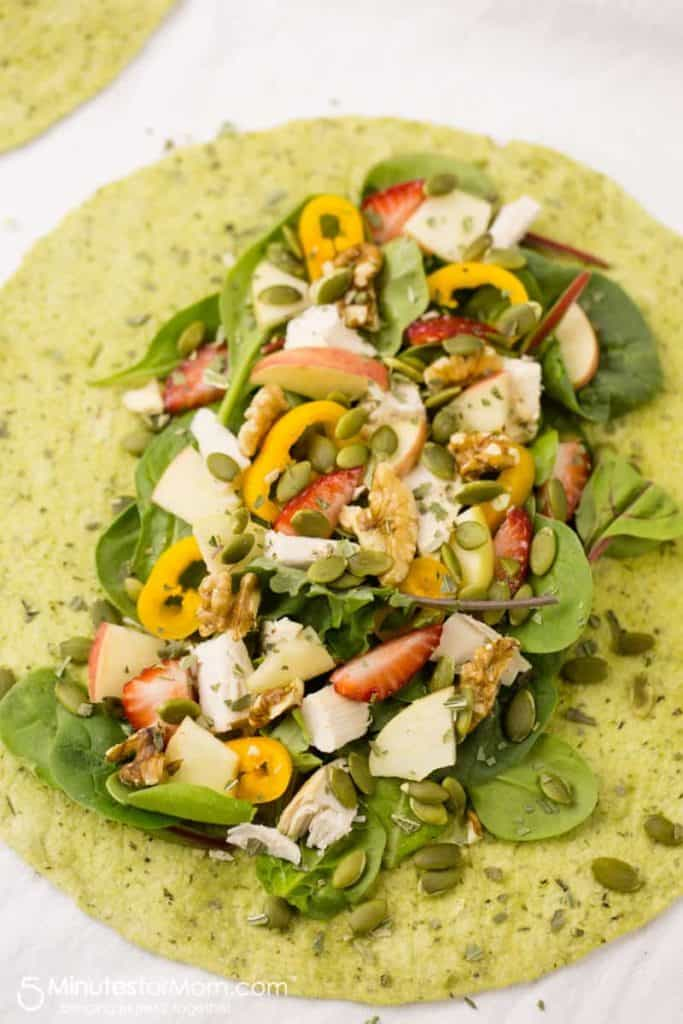 grilled chicken wrap with strawberries, pepitas, shredded chicken and more