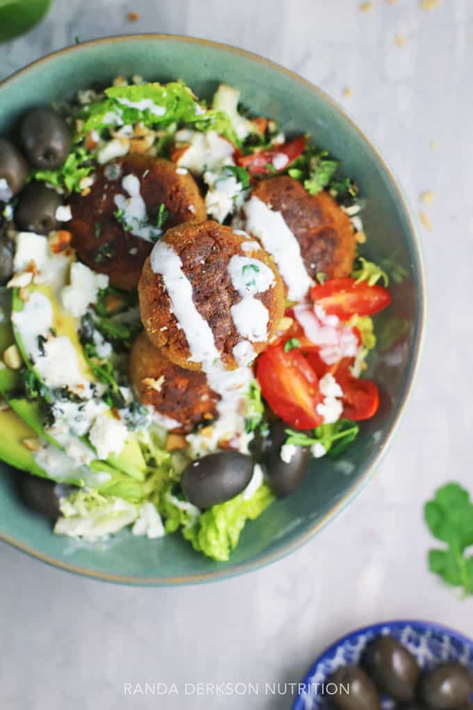 creamy yogurt dressing over baked falafel on a bed of greens.