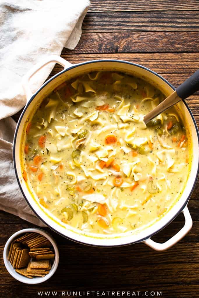 This lightened-up creamy chicken noodle soup is not only easy to make but it's just as comforting as the classic and only 200 calories per serving!