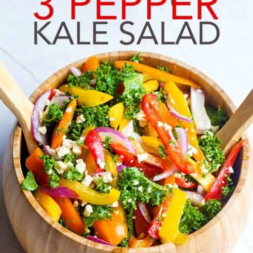A wooden bowl with marinated three pepper kale salad