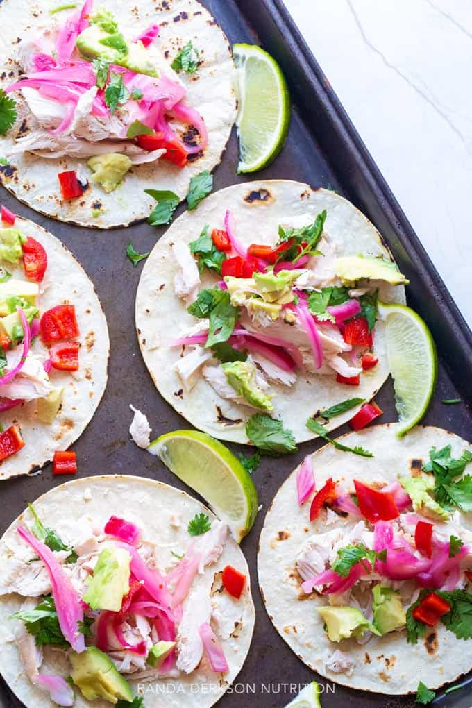 Pickled onion on tacos with lime, cilantro, and chicken
