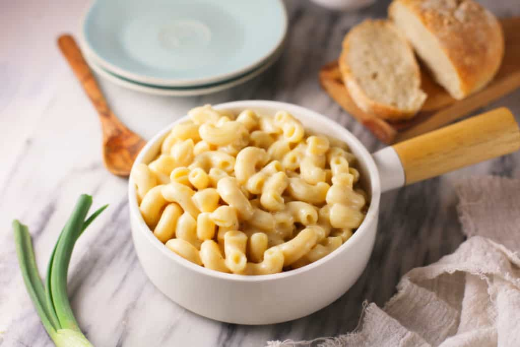 Creamy cauliflower macaroni and cheese in a handled bowl.