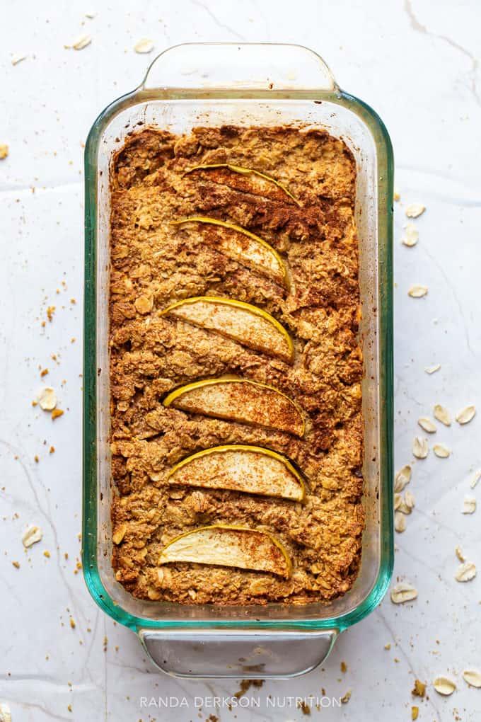 apple oat bread in a glass loaf pan