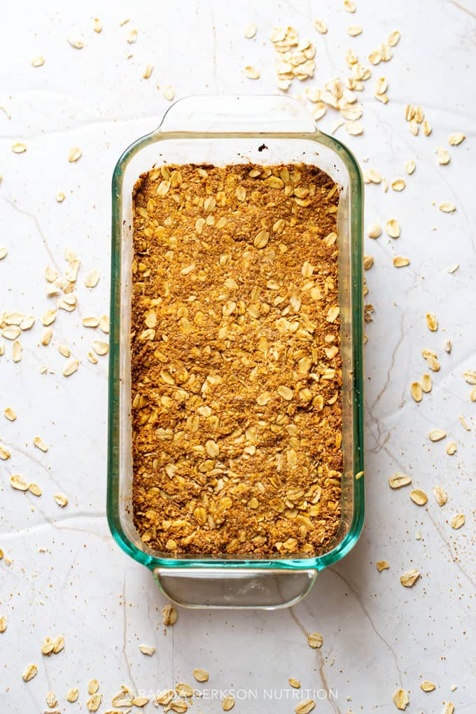 healthy pumpkin granola bars pressed into a loaf pan