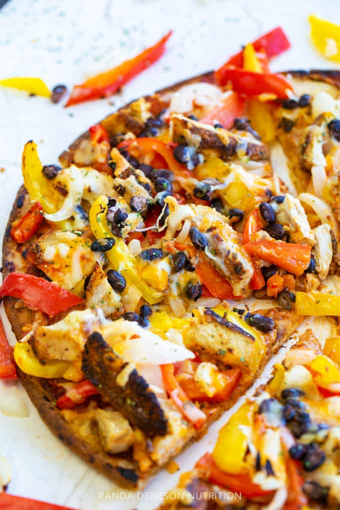 close up of peppers and onions on a chicken pizza on a cauliflower crust