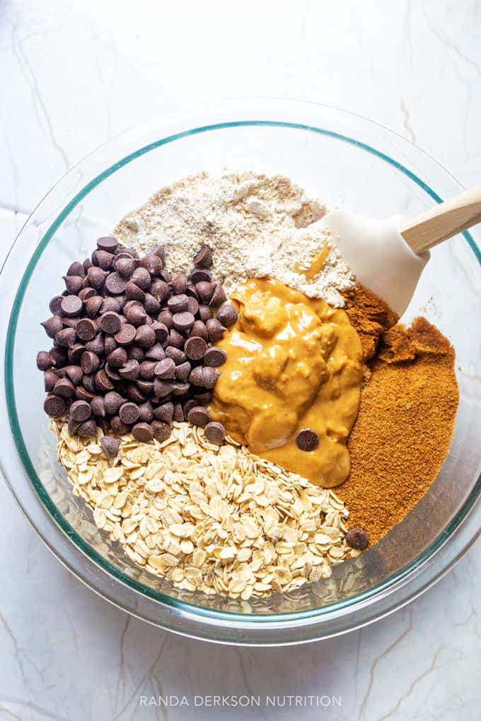 peanut butter oatmeal bars ingredients in a bowl being stirred