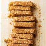healthy pumpkin breakfast bars sliced on a cutting board