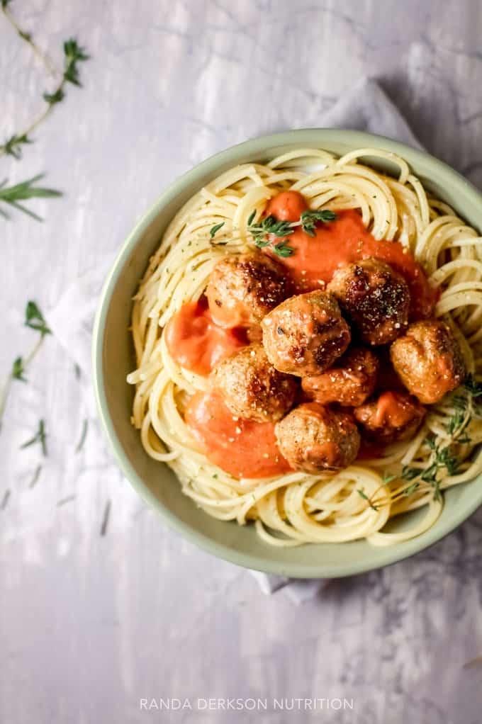veggie loaded meatballs in a healthy tomato sauce over spaghetti