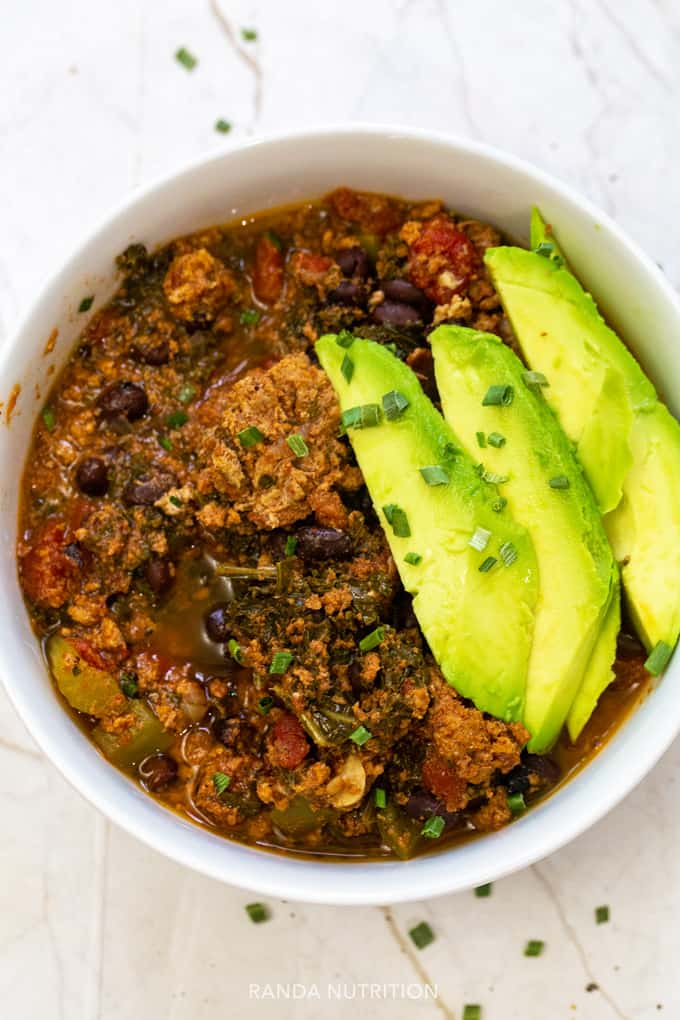 recipe for turkey chili served with avocado