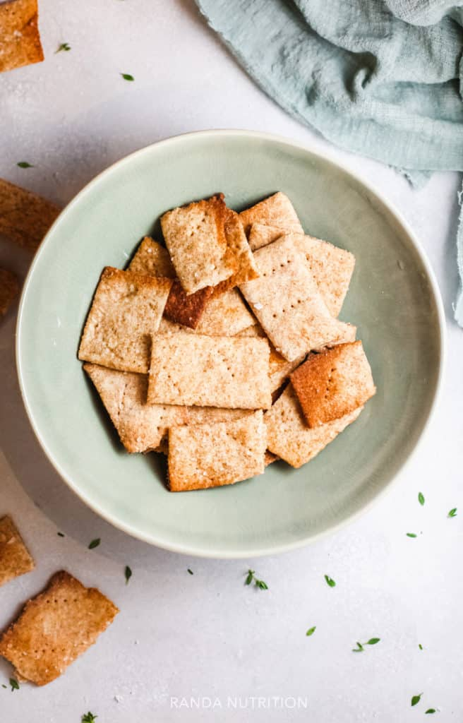 gluten free crackers in a green bowl
