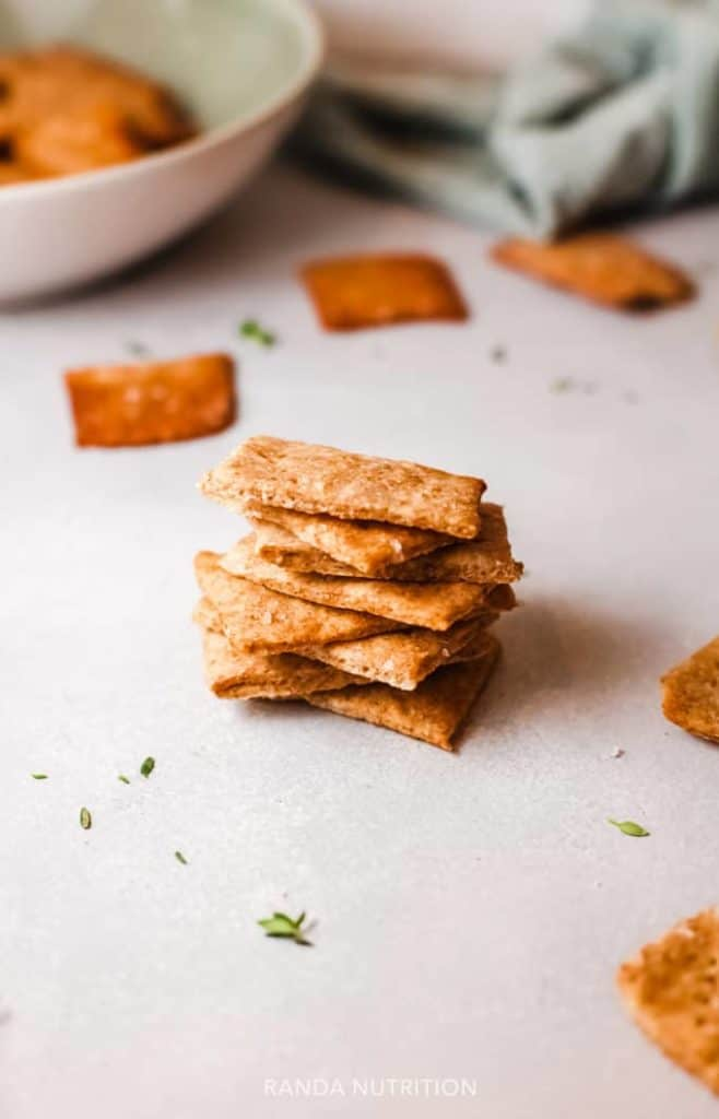 homemade quinoa crackers stacked for snacking