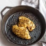 Whole30 chicken recipe: lemon oregano chicken baked in a cast iron pan.