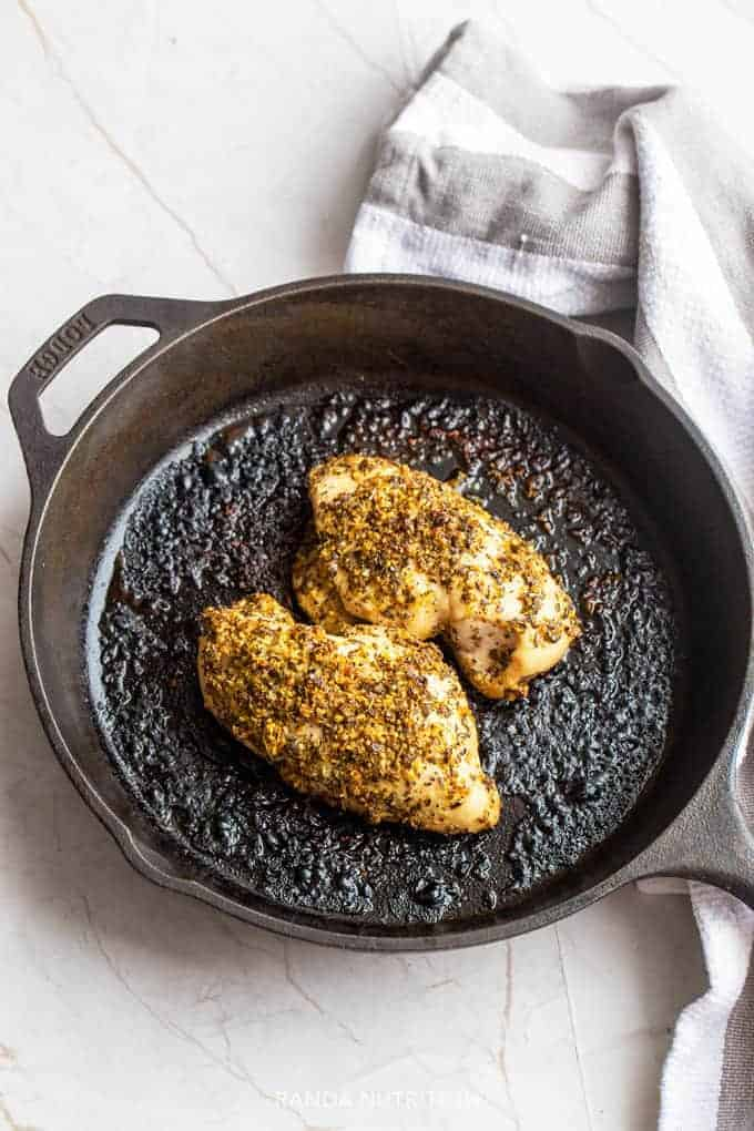Whole30 chicken recipe: lemon oregano chicken baked in a cast iron pan.