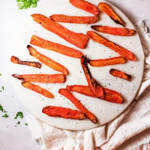 roasted carrot strips or fries on a platter