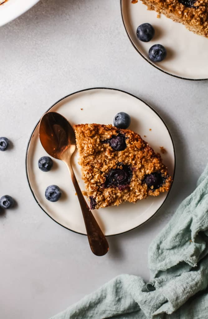 a slice of baked oatmeal with blueberries on top