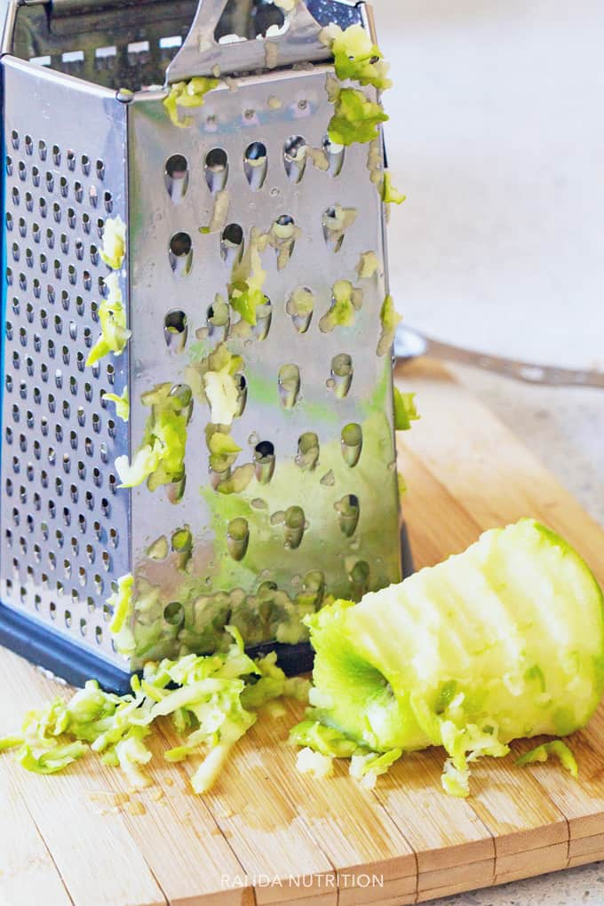 grating apples with a cheese grater
