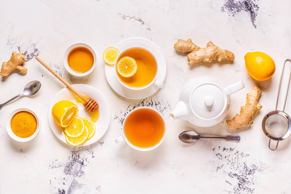 heartburn teas on a white background with lemon and ginger