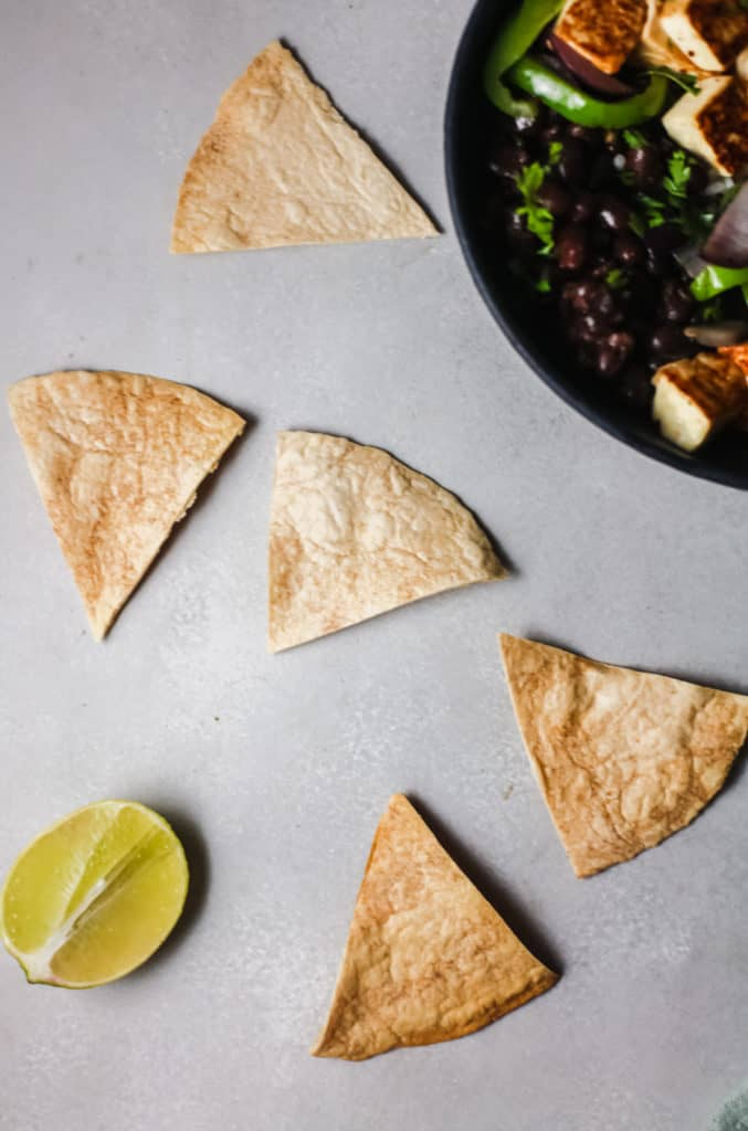 homemade tortilla chips in triangle shapes for topping fajita bowls