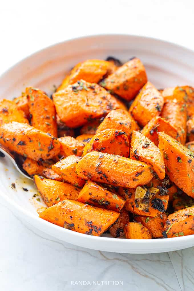 roasted carrots with spices sliced in a bowl