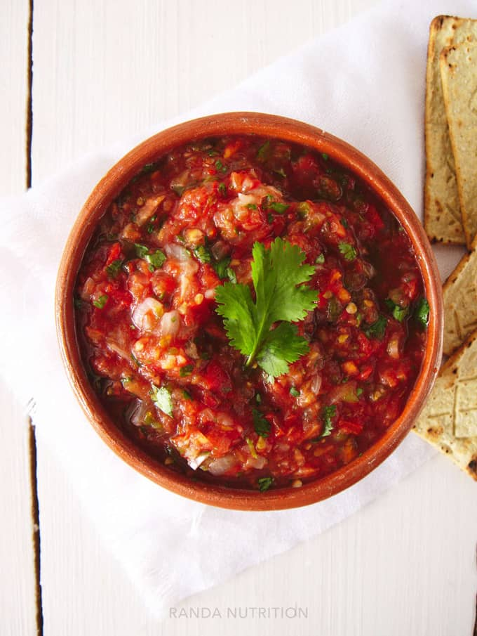 homemade salsa topped with fresh cilantro