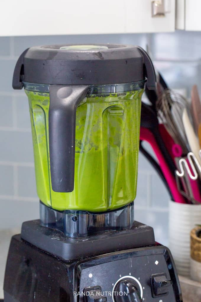 blending a green smoothie in a Vitamix
