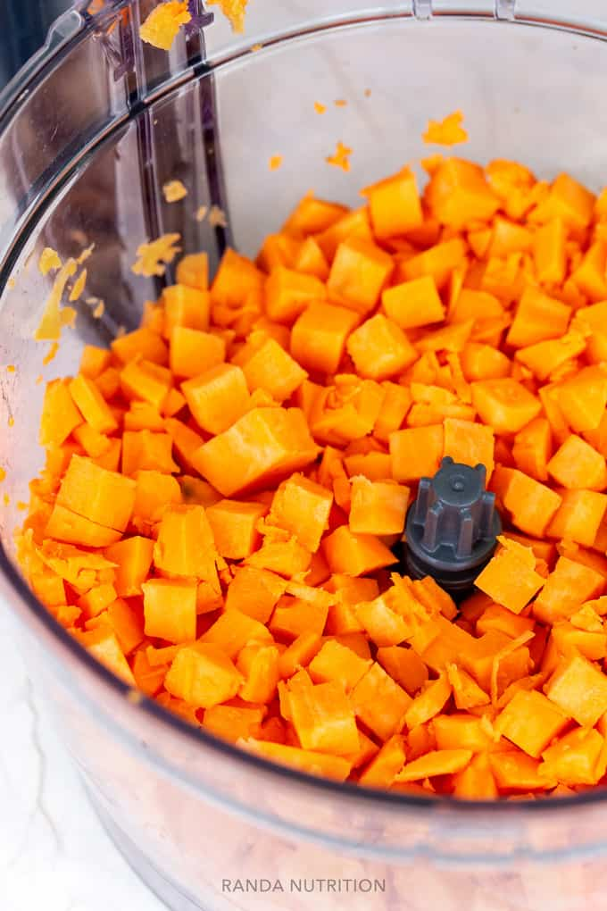 cubed sweet potatoes in a food processor with a dicing kit