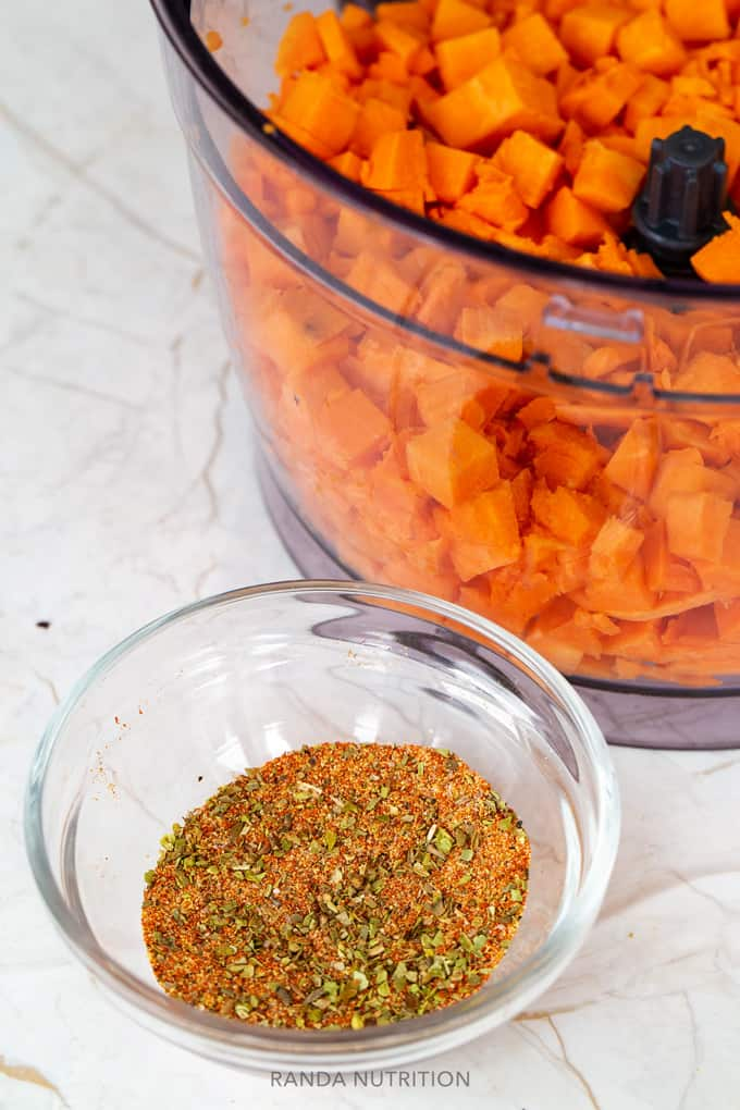 homemade spice mix with diced sweet potatoes in a food processor