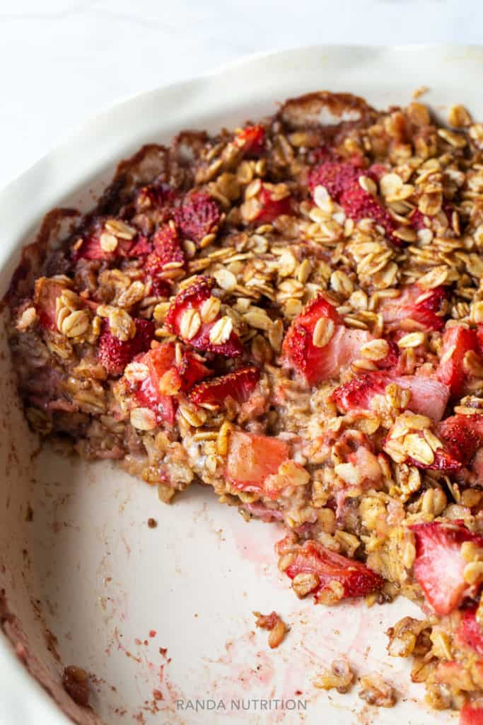 Two pieces of baked oatmeal missing out of a baking pan.