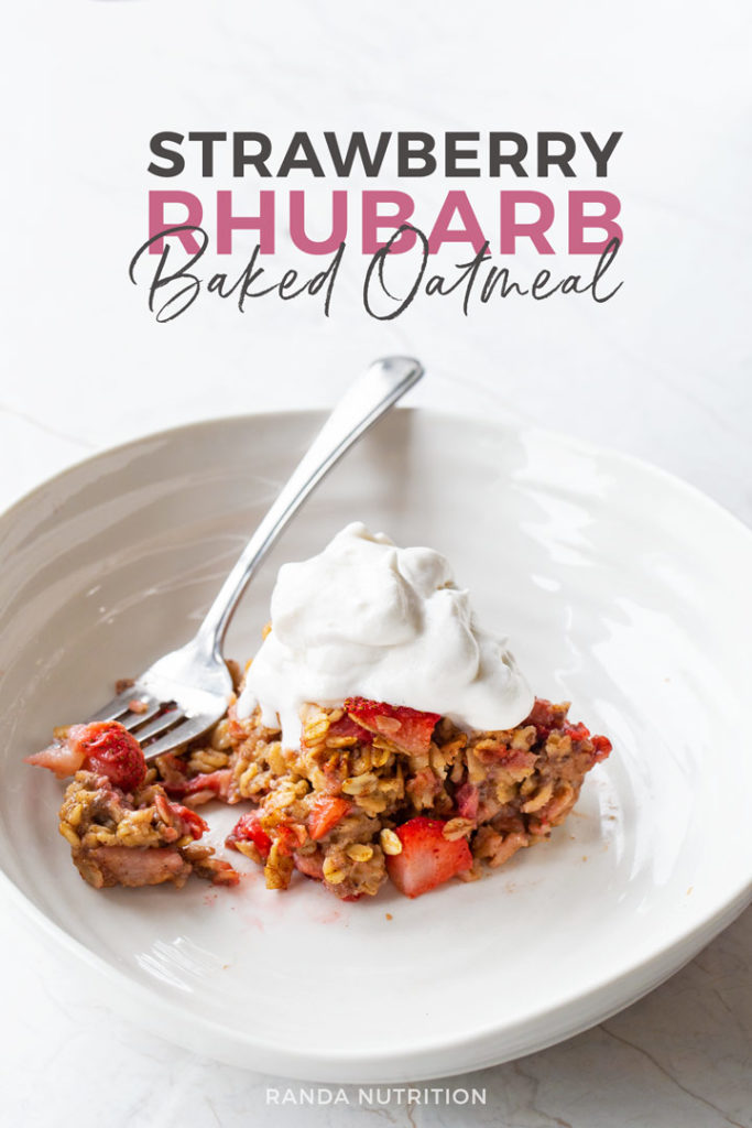 strawberry rhubarb baked oatmeal topped with coconut whipped cream