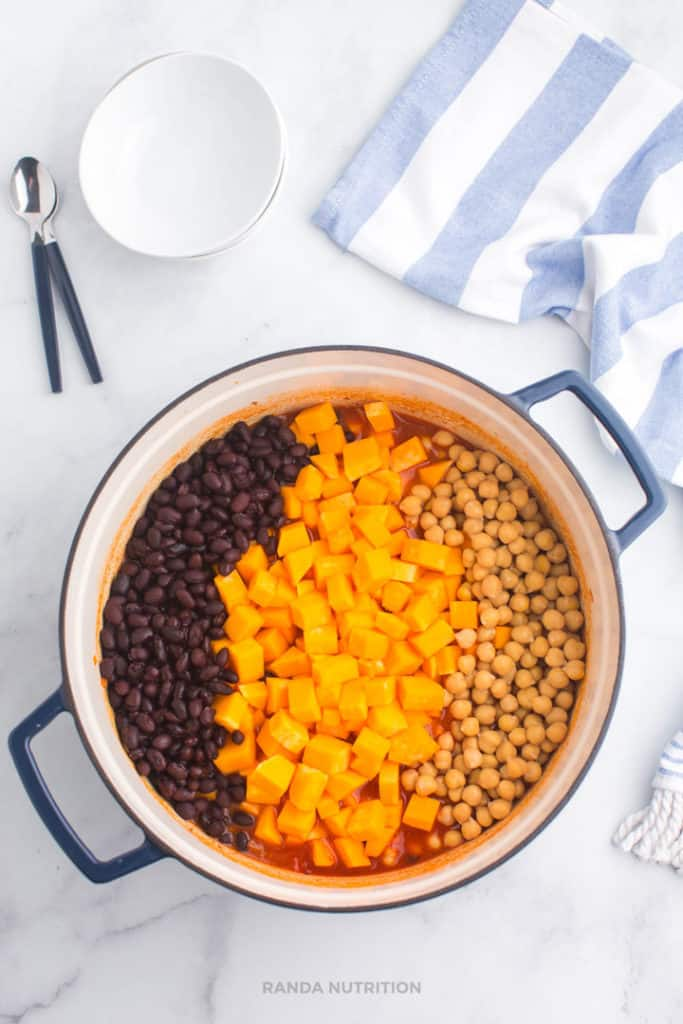 butternut squash, black beans, and chickpeas on top of chili