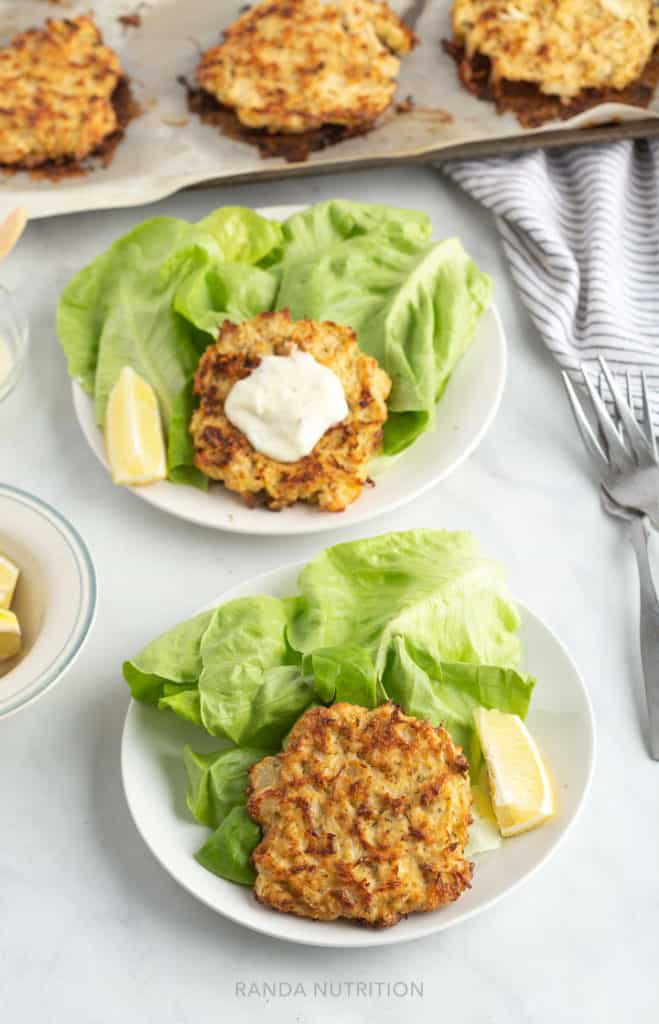 gluten free crab cakes on a bed of bibb lettuce and tartar sauce