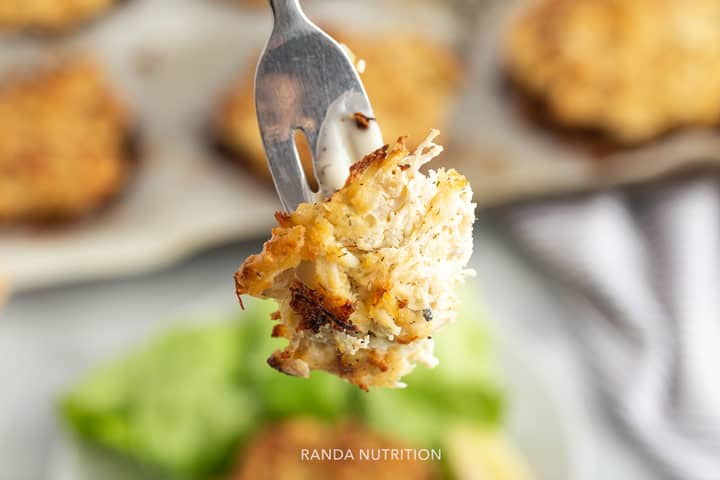 a forkful of cooked crab cakes