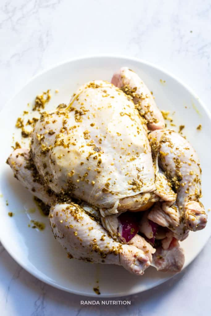 whole chicken rubbed with pesto