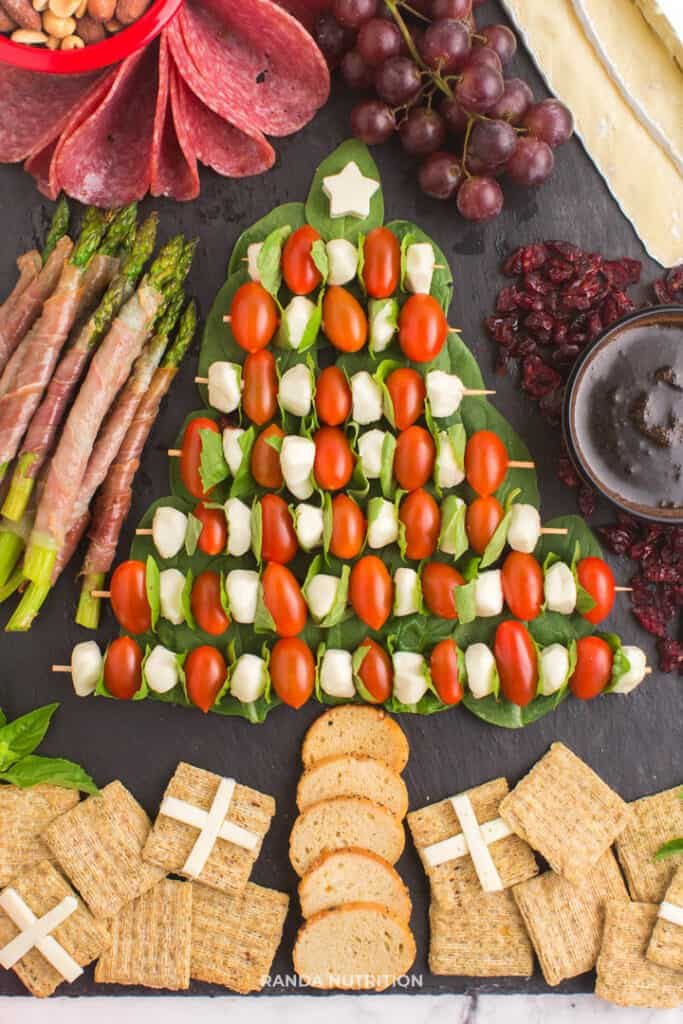 a charcuterie board in shape of a Christmas tree