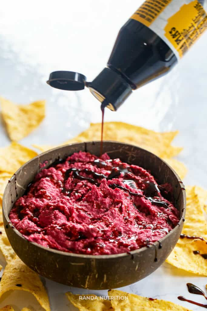 Nonna Pie's balsamic glaze being drizzled over beet dip
