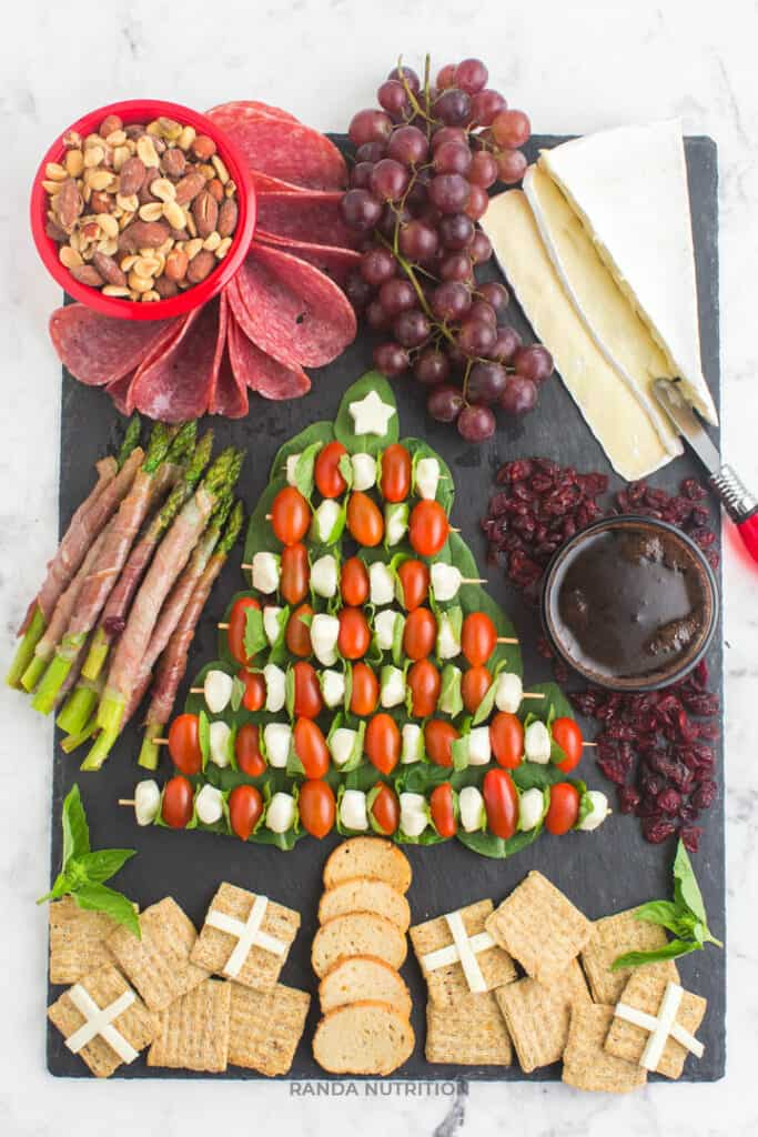 pretty charcuterie board in shape of a Christmas tree
