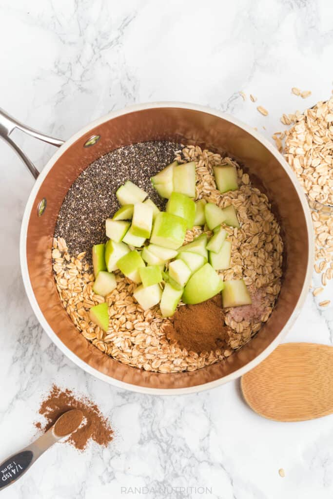 chia seed, apples, rolled oats, cinnamon, maple syrup, vanilla extract in a sauce pan