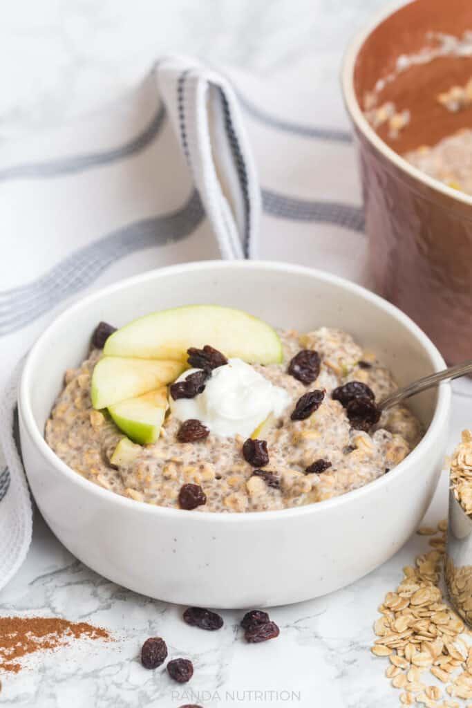 side shot of breakfast oatmeal with fruit, raisins, and greek yogurt