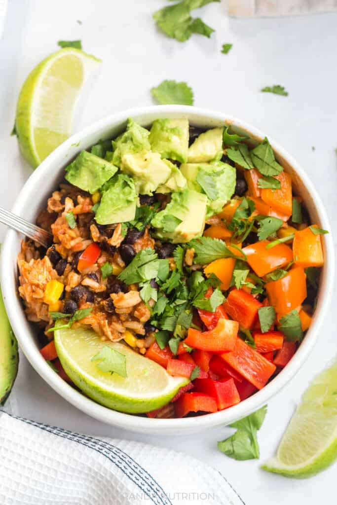 easy chicken burrito bowls that were cooked in the instant pot and topped with avocado and cilantro