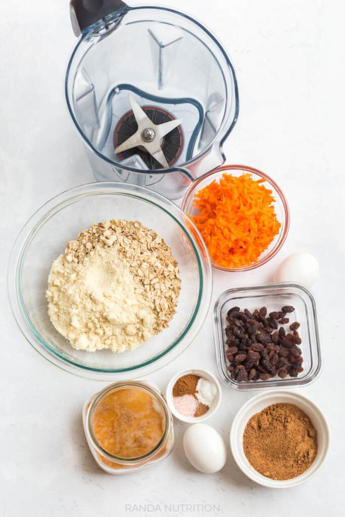 ingredients needed to make carrot muffinsThis recipe for moist, healthy carrot cake muffins is so easy because they're blender muffins. Easy clean up and gluten free, makes these recipes suitable for any diet and they're easy to make vegan.