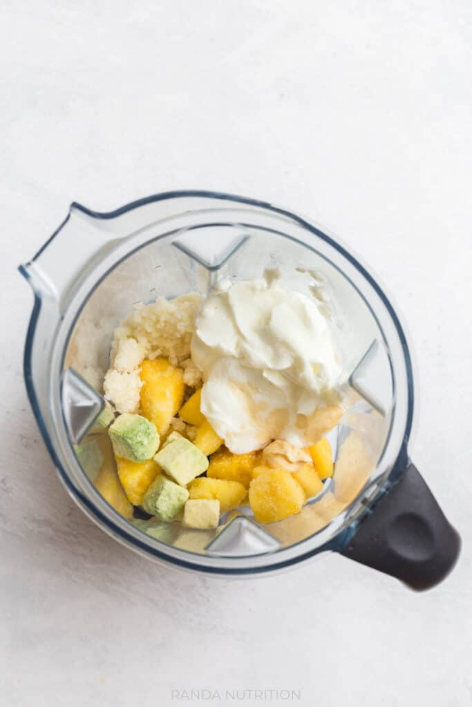 pineapple avocado coconut smoothie behind made in the Vitamix