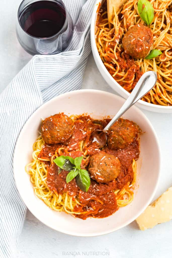 overhead view of homemade meatballs in a red wine marinara sauce