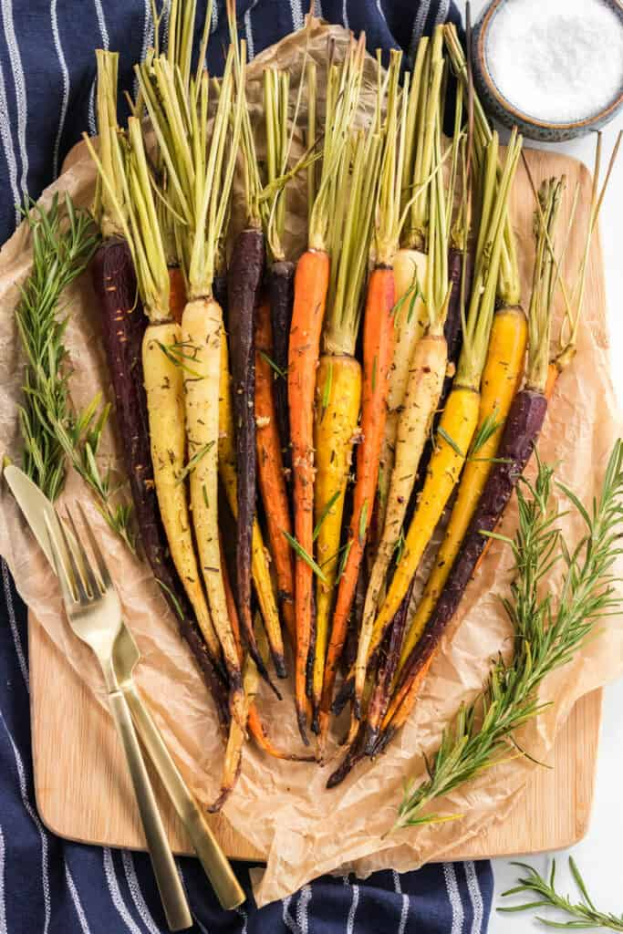 bunch of carrots on parchment paper fresh out of the oven